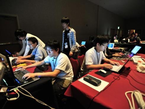 """NEED FOR STRENGTHENING: """"Every sector that depends on computer networks has suddenly been left extremely vulnerable."""" Picture shows a team competing in the CTF contest at DEFCON, one of the world's largest annual hacker conventions, in Las Vegas. — PHOTO: NATE GRIGG, CC 2.0"""